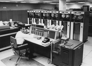 person working on IBM 7094